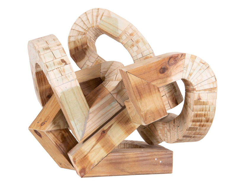 Picture of an abstract wooden sculpture by Jed Smalle