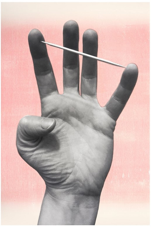 picture of a hand and toothpick