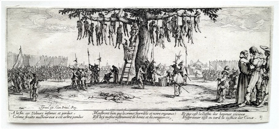 picture of bodies hanging in a tree
