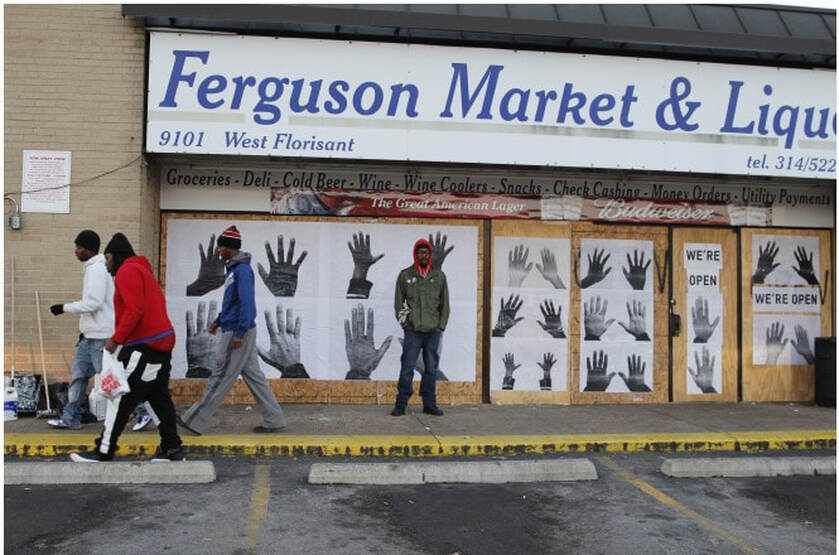 Picture of Damon Davis in Ferguson, MO, 2014.